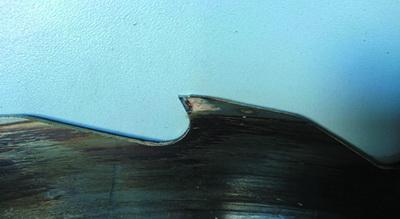 Рис. 12. Некачественная заточка зуба по задней грани