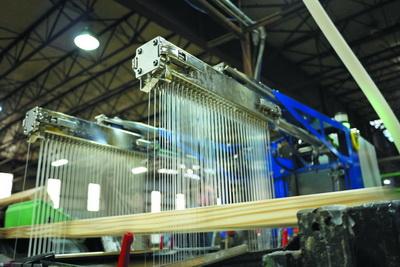 Рис. 1. Установка 7230 EcoFlex для раздельного нанесения компонентов клеев