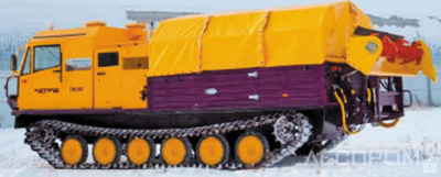 Рис. 5. Гусеничный вездеход ЧЕТРА ТМ-140, агрегатированный роторным рыхлителем