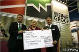 Вручение сертификата на 5 тысяч евро для детского дома в Томилино на стенде Weinig