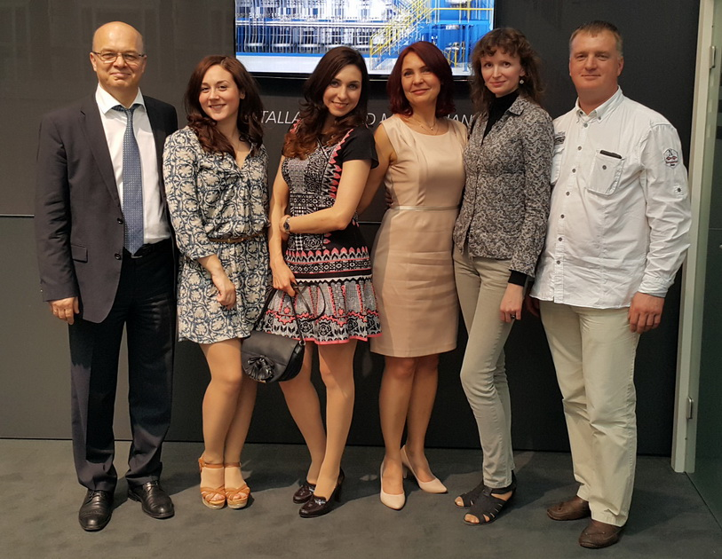 Julia Valajne, Elena Shumeyko and Svetlana Yarovaya with the customers