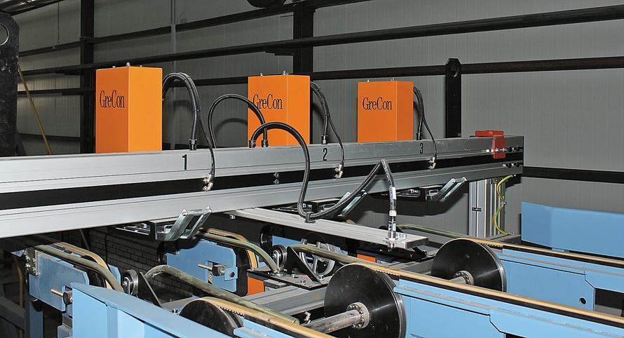 Установка DMR 5000 для измерения толщины листов фанеры фирмы GreCon
