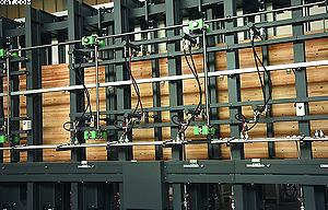 Механизм бокового выравнивания пакетов ламелей