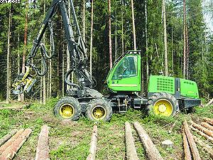 Валка леса харвестером John Deere